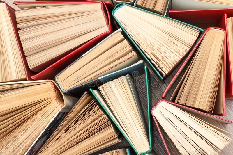 Large number of colorful books. Used hardback books. View from a stock photography