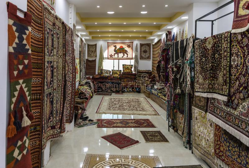 A large number of decoratively decorated floor and wall carpets for sale in a roadside store near Maan city in Jordan royalty free stock photos