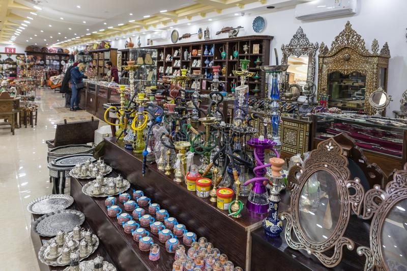 A large number of decoratively decorated hookahs and tobacco for them for sale in a roadside store near Maan city in Jordan royalty free stock photography