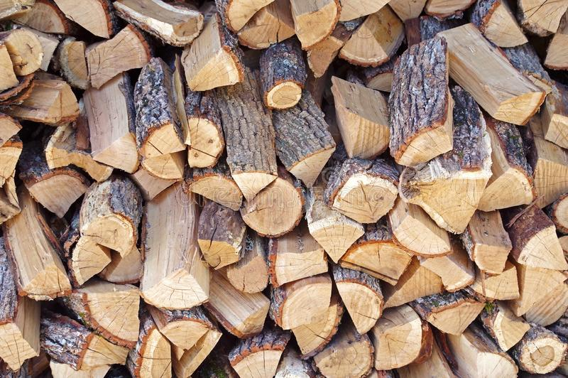 A large number of firewood. Neatly laid for later use stock images
