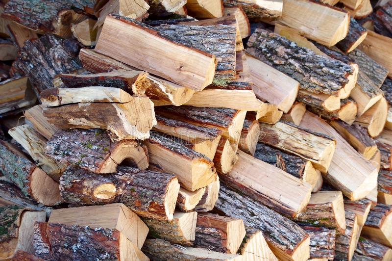 A large number of firewood. Neatly laid for later use royalty free stock images
