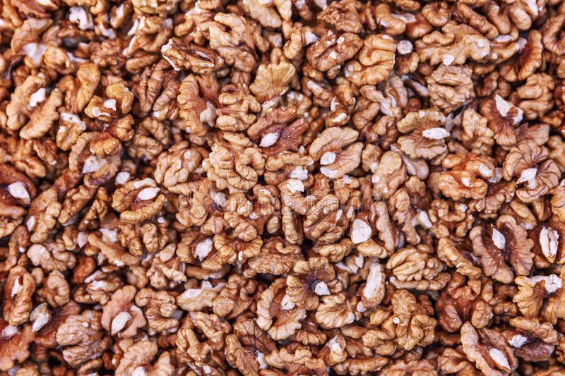 A large number of peeled walnuts. Background. Close-up. Horizontal royalty free stock image