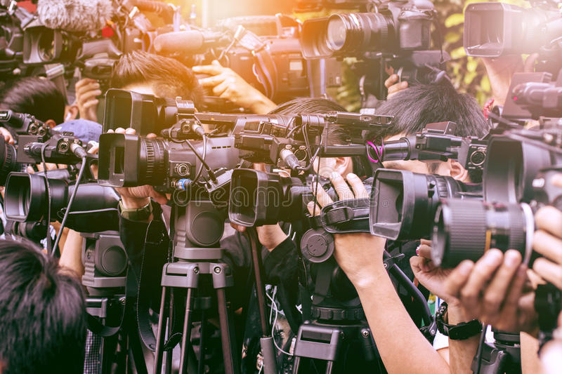 Large number of press and media reporter in broadcasting event stock images