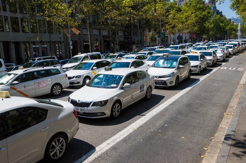 Barcelona, Spain; July 29 2018: Strike of taxi drivers against Uber and Cabify. A large number of Taxi blocking the street of Gran Via de les Cortes Catalanes in royalty free stock photo