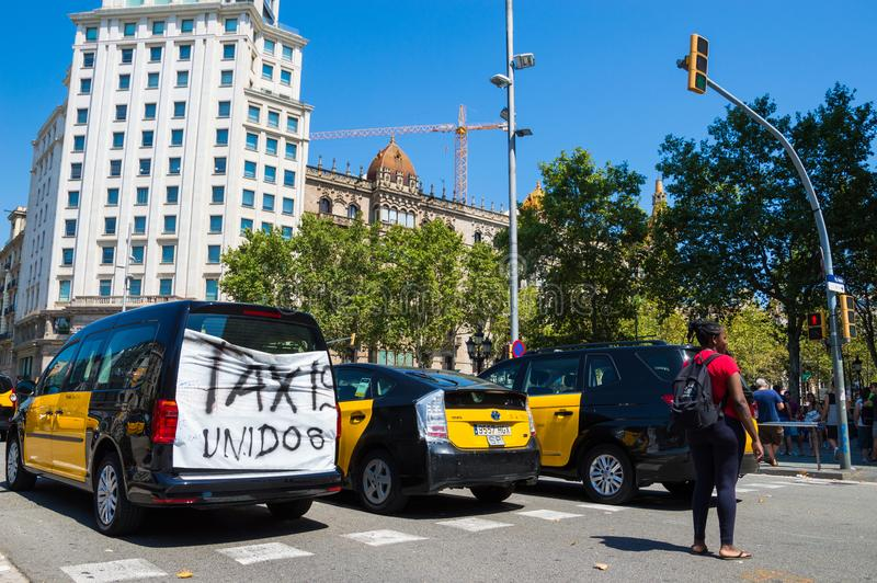 Barcelona, Spain; July 29 2018: Strike of taxi drivers against Uber and Cabify. A large number of Taxi blocking the street of Gran Via de les Cortes Catalanes in stock images