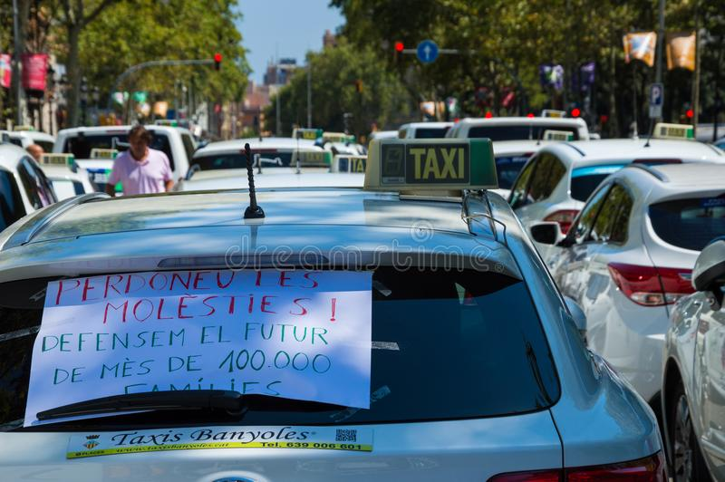 Barcelona, Spain; July 29 2018: Strike of taxi drivers against Uber and Cabify. A large number of Taxi blocking the street of Gran Via de les Cortes Catalanes in royalty free stock photography