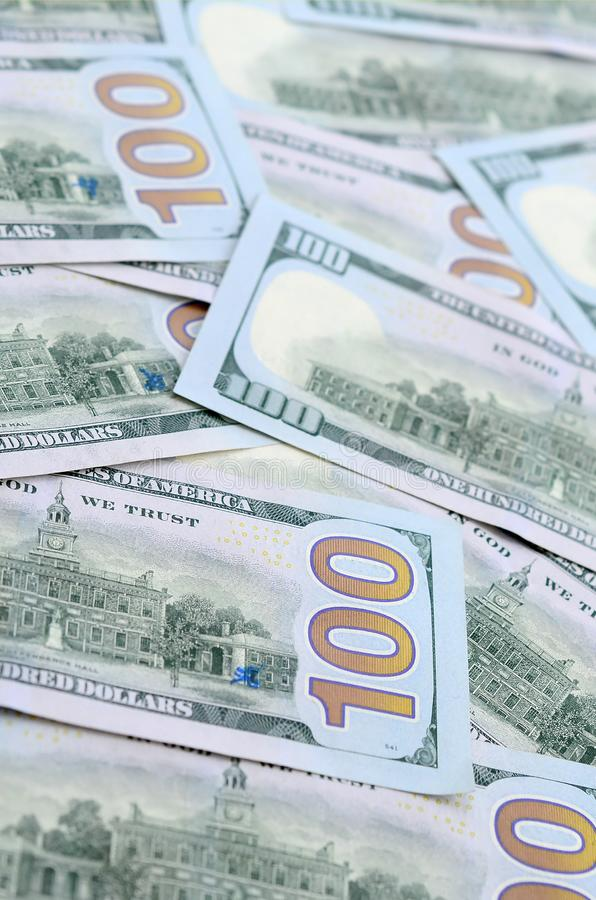 A large number of US dollar bills of a new design with a blue stripe in the middle. Top view.  stock photography