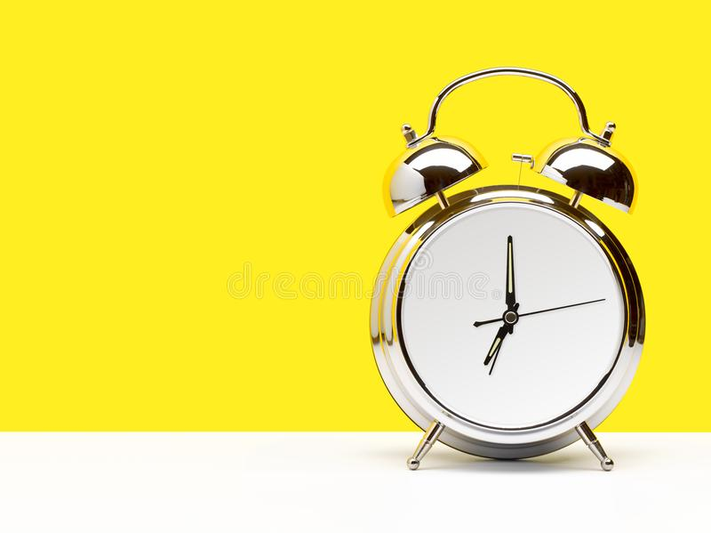 A large old antique alarm clock with bells royalty free stock photos