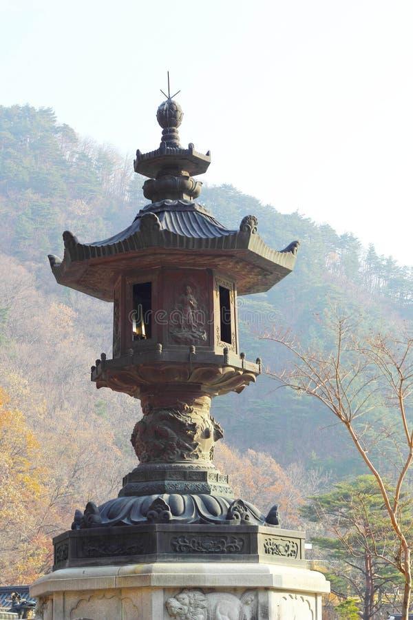 Large old antique lantern post Seoraksan Korea. royalty free stock image
