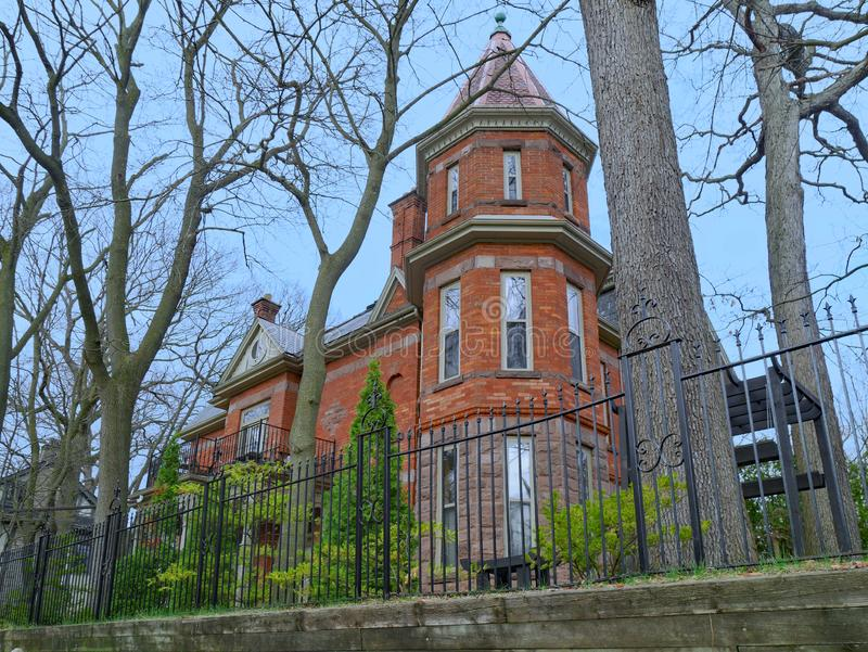 Large old brick house with turret stock photography