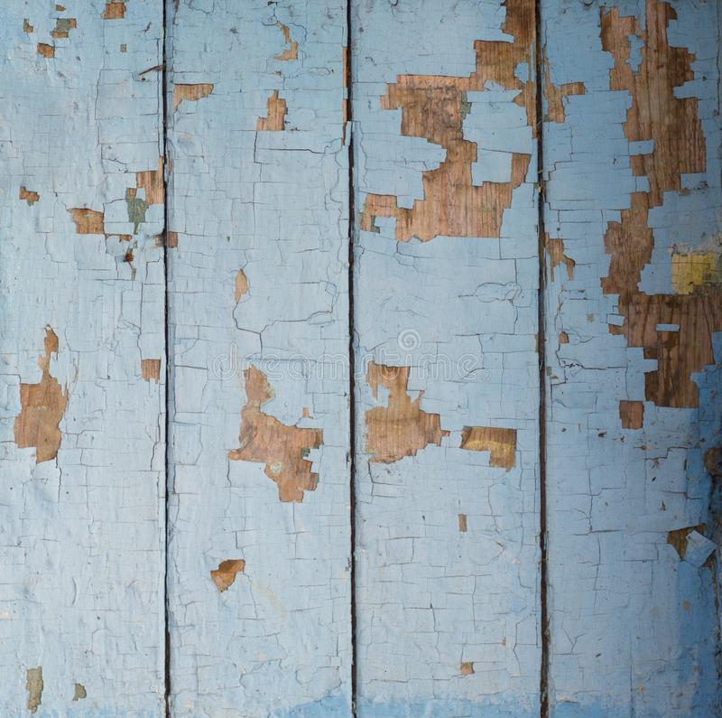 Large old wooden blue boards with crumbling paint shaded royalty free stock image