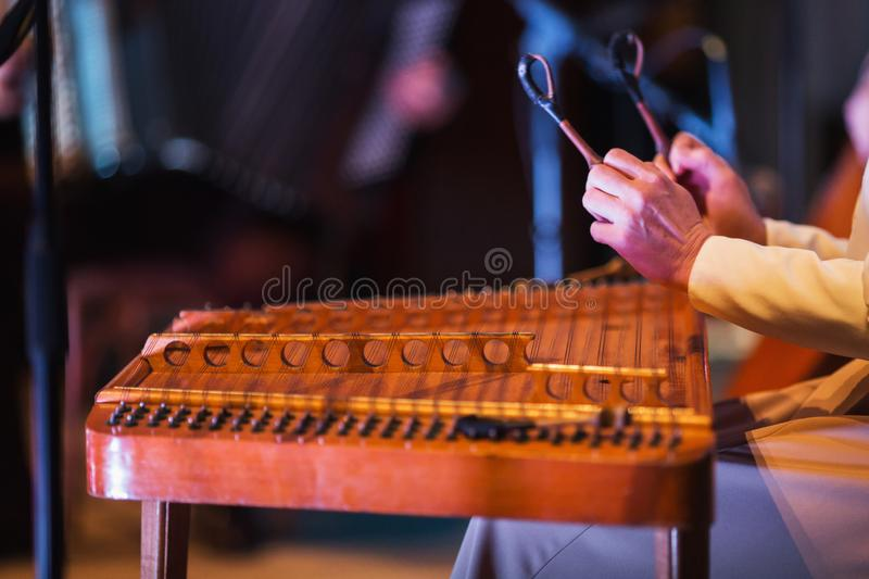 Large old wooden cymbals. Old Russian musical instrument. Hands close up. String stock images