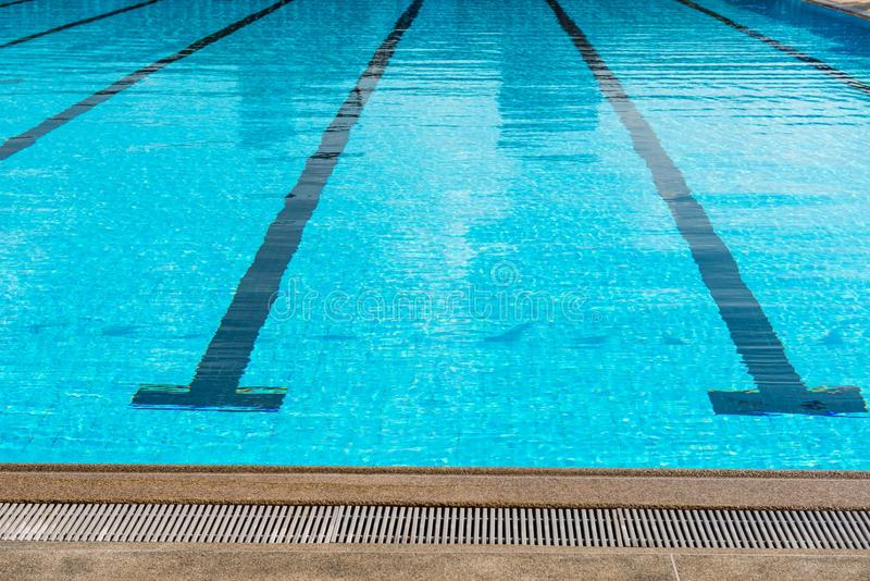 Large olympic size swimming pool with racing lanes stock image