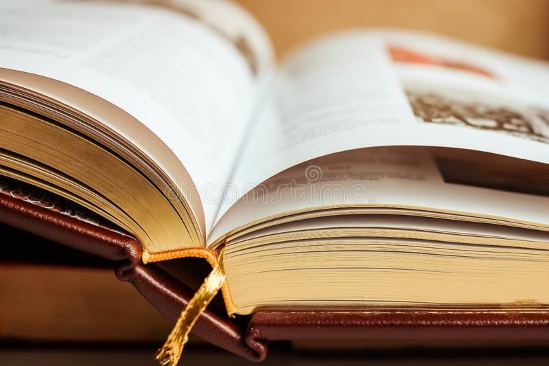 Large open book with golden pages and gold bookmark close up. royalty free stock image