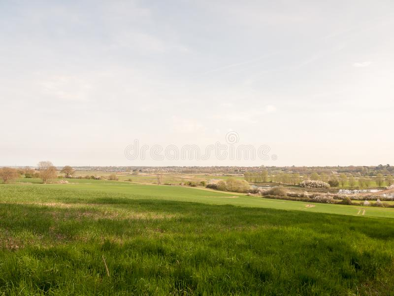 Large open field farm country valley spring sky ground background nature Dedham Vale. Essex; england; uk royalty free stock image