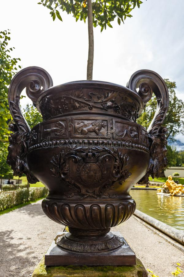 Large ornate garden urn. Outdoors in the centre of a walkway in a formal botanical garden or park stock photo