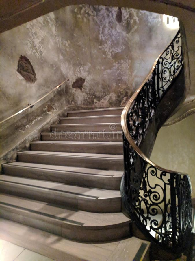 Grand staircase. Large ornate stone and iron staircase stock image