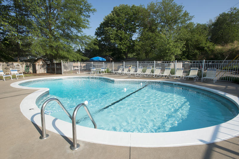 Large outdoor pool. Large clean outdoor pool on clear day royalty free stock photos