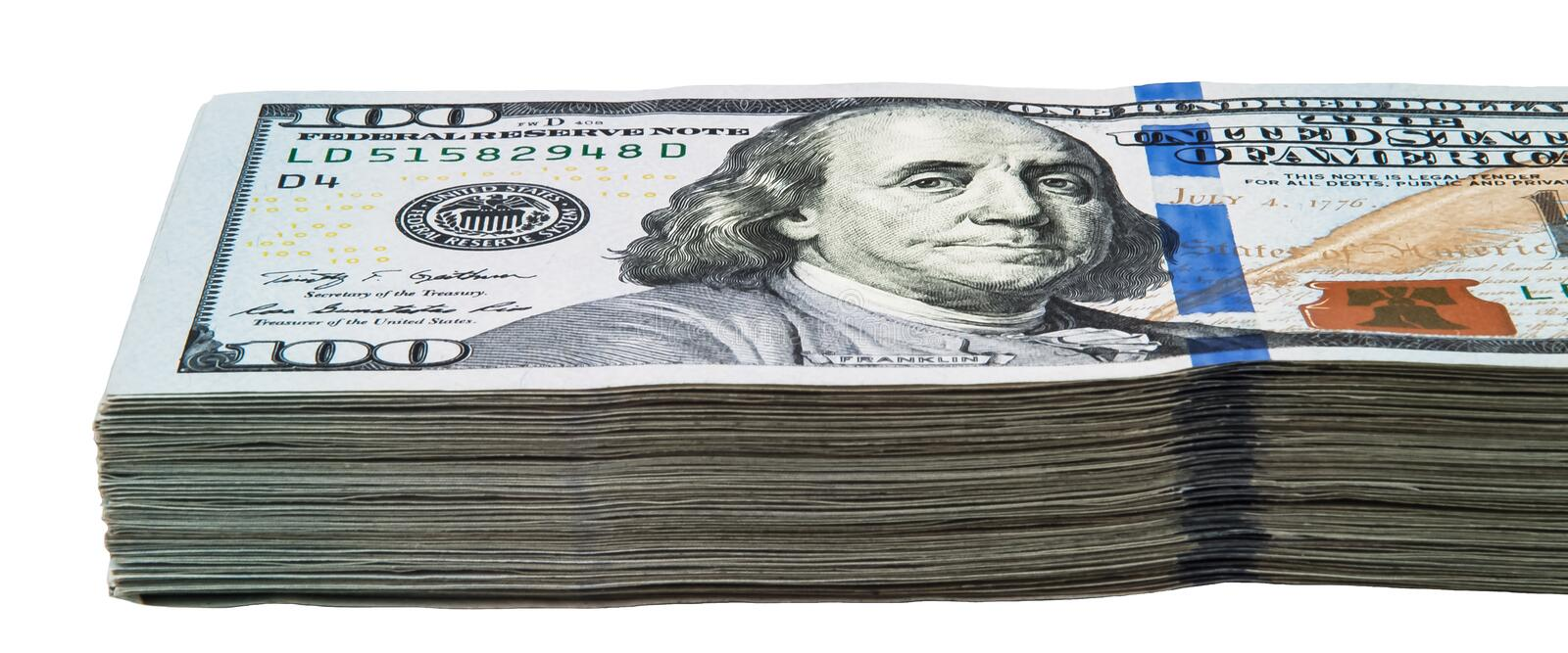 A large pack of one hundred American dollars bills on a white background. stock photos