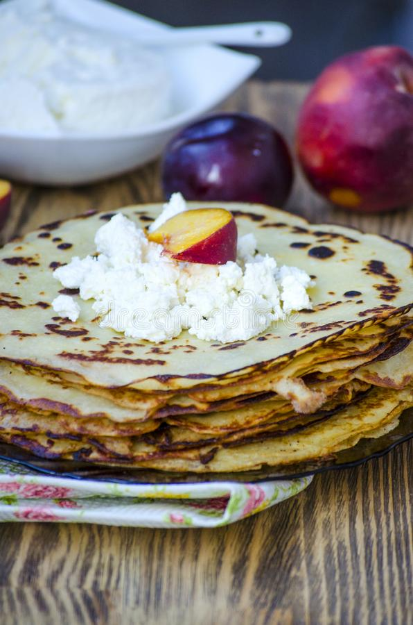 Big stack of pancakes with blueberries and raspberries stock photography