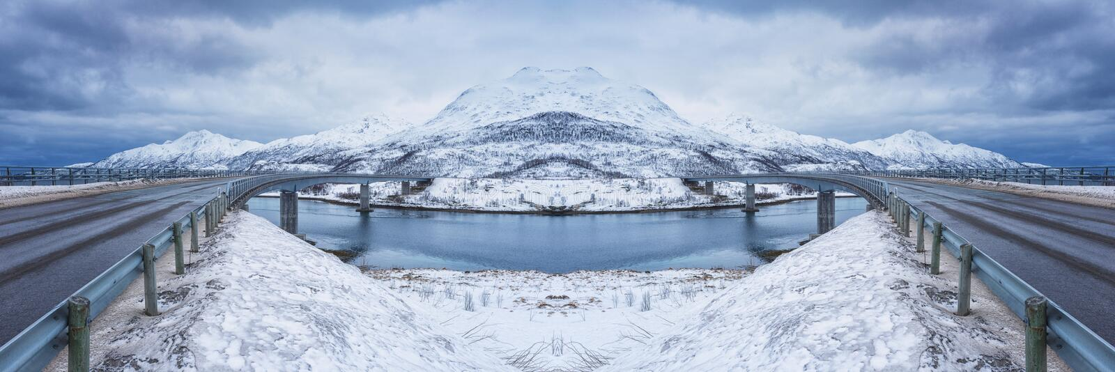 Large panorama with two symmetric roads between islands in winter, composite image. Lofoten Islands, Norway stock images