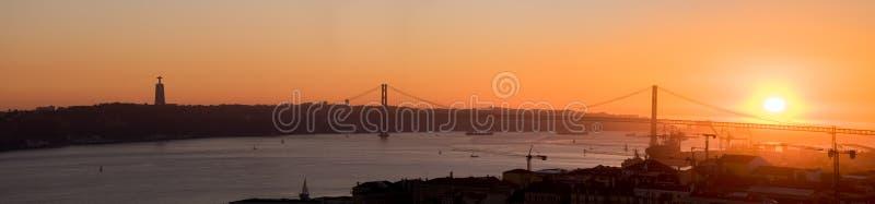 Large panoramic view of Amazing sunset on Ponte 25 de Abril Bridge, 25th of April Bridge at Lisbon stock images
