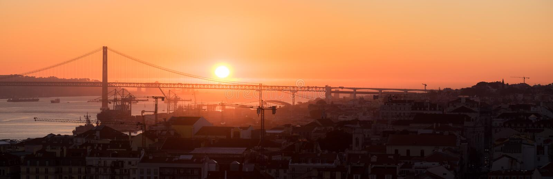 Large panoramic view of Amazing sunset on Ponte 25 de Abril Bridge, 25th of April Bridge at Lisbon stock photography