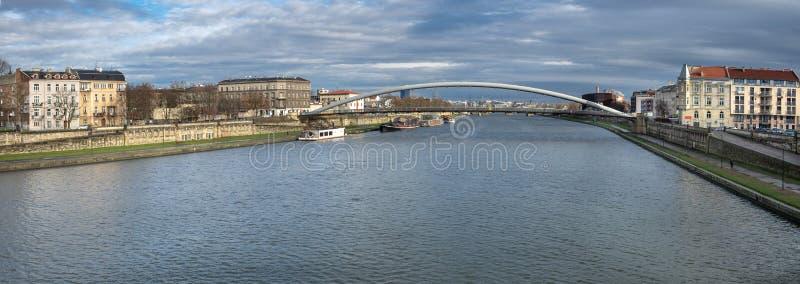 Large panoramic view of The Lovers Bridge Bernatek Footbridge on Vistula River. Krakow royalty free stock images