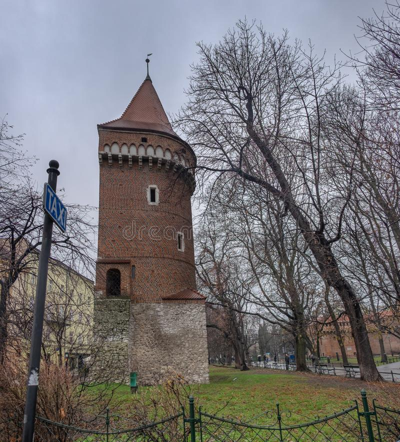 Large panoramic view of Watch tower of medieval defence walls at Krakow Old Town. Fragment stock photo