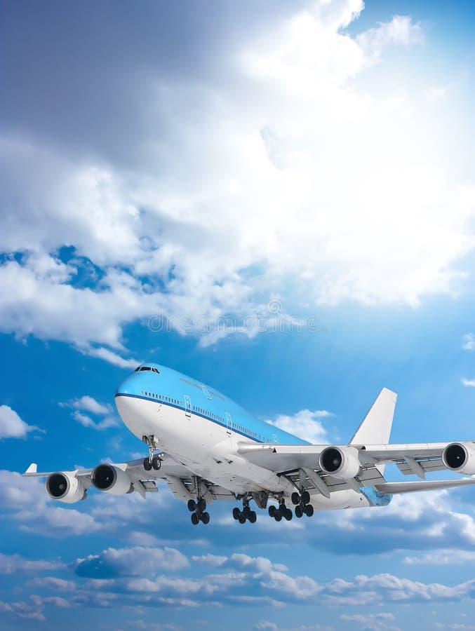Large Passenger Plane  In  Blue Sky Royalty Free Stock Image