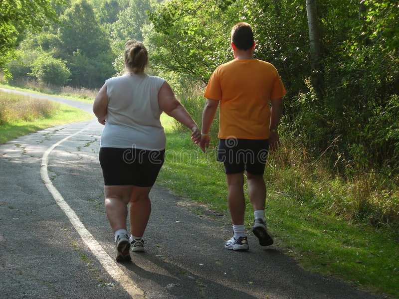 Large people walking on trail stock images