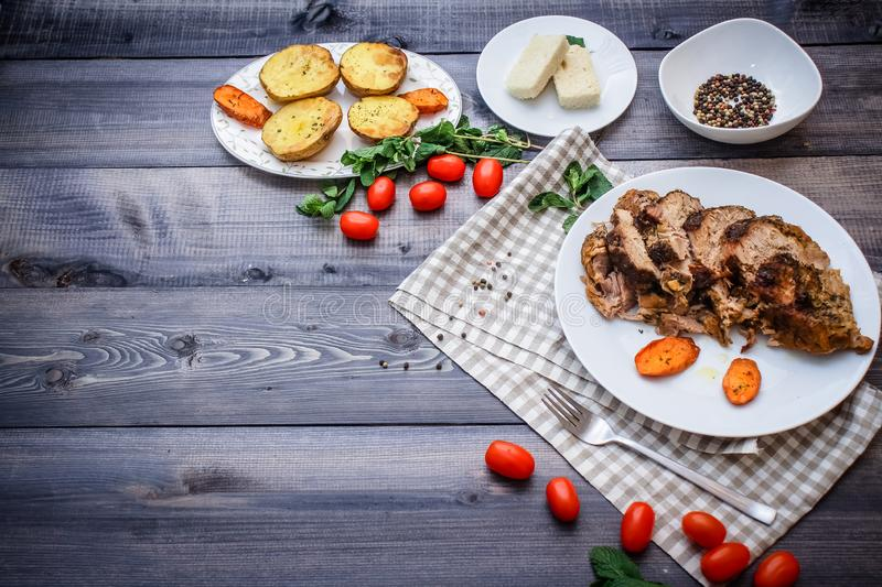 A large piece of baked meat Still life on a light wooden table stock image