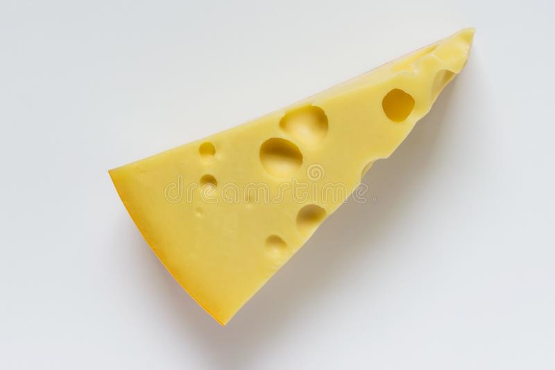 Large piece of Maasdam cheese with large pores holes royalty free stock images