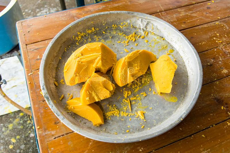 Large pieces of beeswax for making of candle for the Lent tradition in Thai temple , Thailand. royalty free stock image