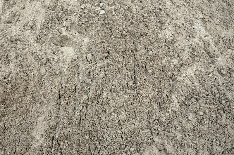 Large pile of construction sand close up as texture and background stock photography