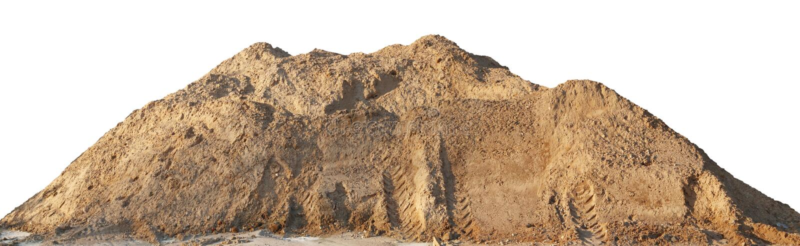 A large pile of construction sand with traces of tractor wheels royalty free stock photo