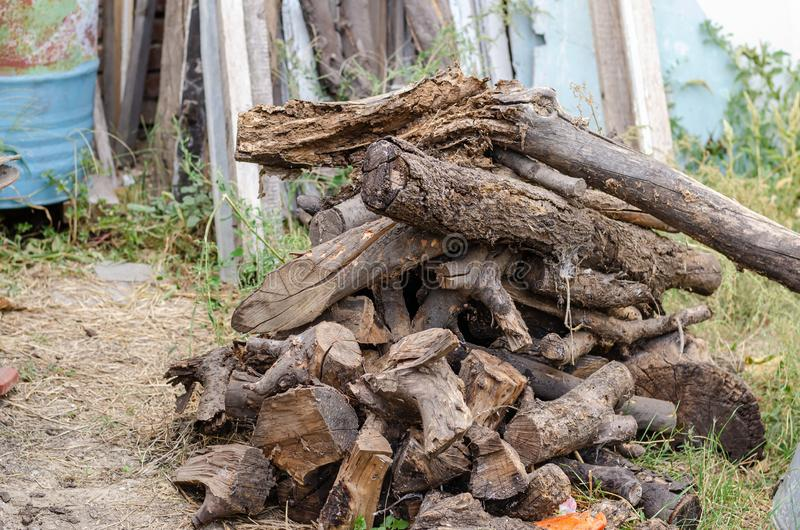 A large pile of fruit logs in the backyard of a rural house. royalty free stock image