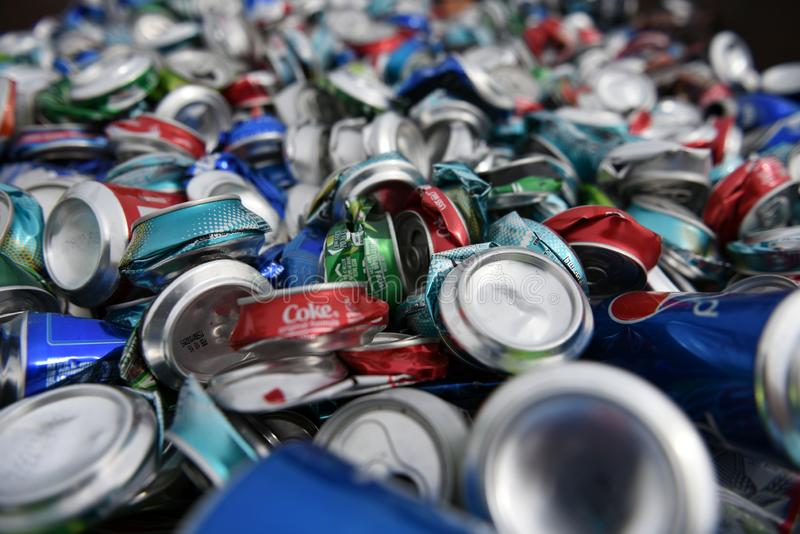 Large pile of loose, smashed, crushed, empty, used aluminum beer and soda beverage cans royalty free stock photos