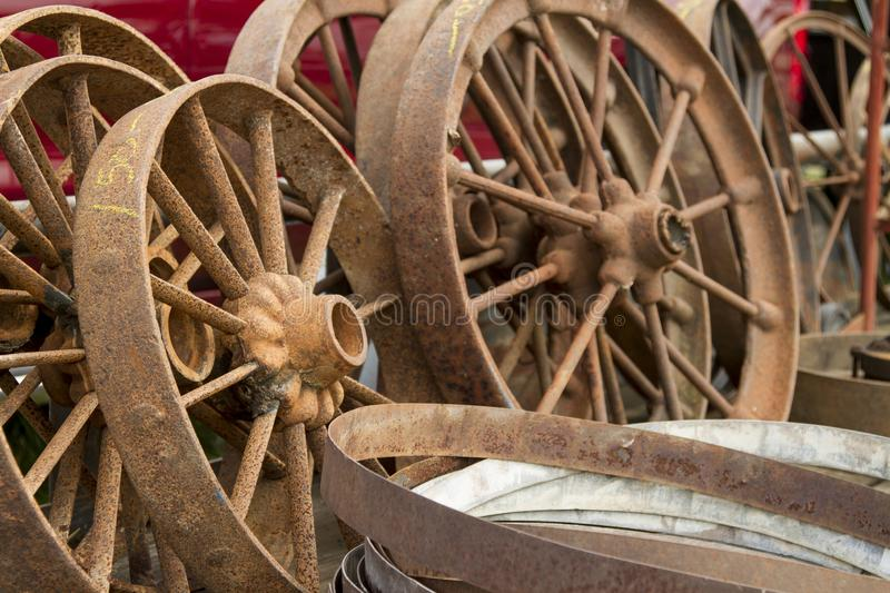 Large pile of rusted wagon wheels royalty free stock photography
