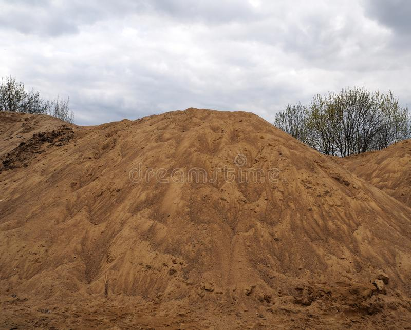 Large piles of construction sand stock image