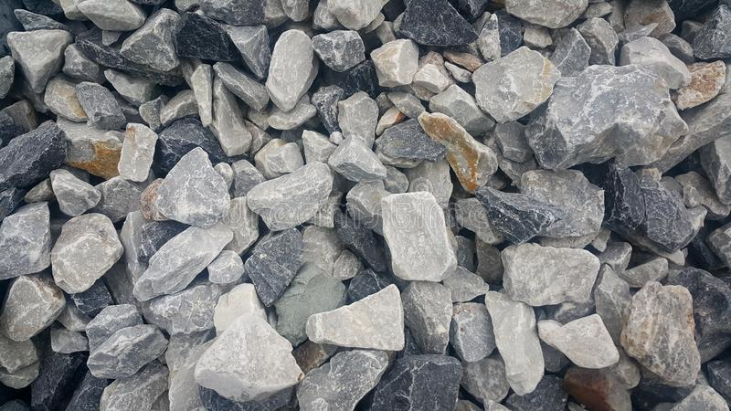 Large piles of limestone for use in lime kiln line Large and small piles of limestone for use in lime kiln line royalty free stock photo