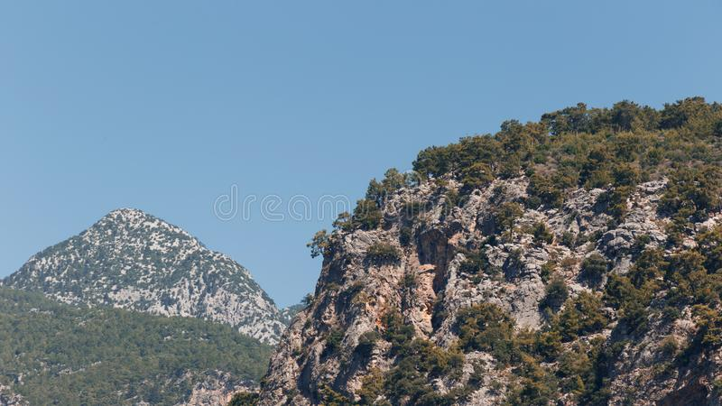 Large pine trees grow on top of the mountains. Beautiful landscape in the mountains. Lovely view of the Taurus Mountains royalty free stock images