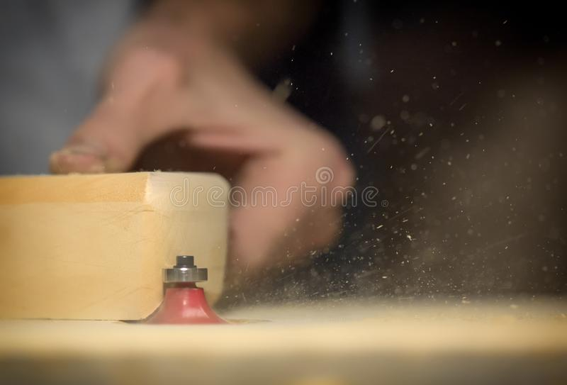 A large plan, hands of an artisan working on a wooden part royalty free stock photography