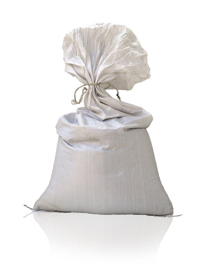 Large plastic sack on white background. Large plastic sack tied vinyl rope isolated on white background royalty free stock image