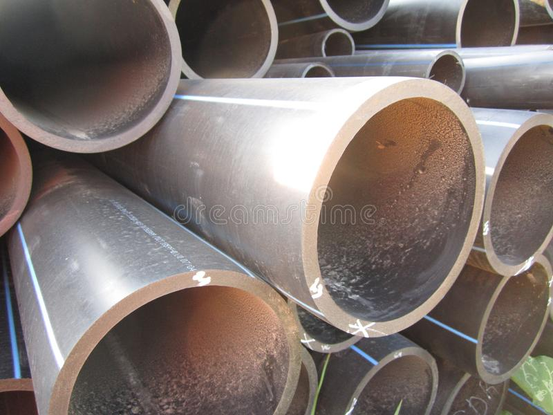Large plastic tubes. Plastic black corrugated pipes of large diameter for the installation of sewage and water supply royalty free stock image