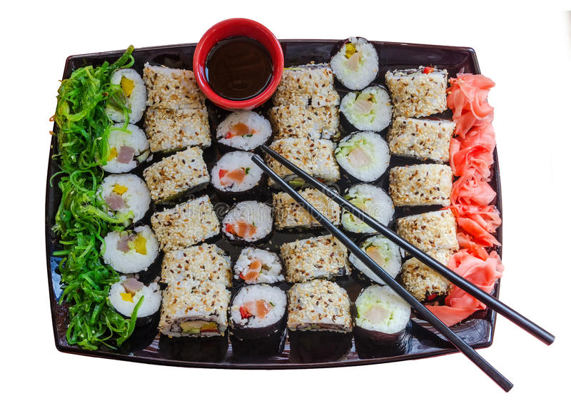 A large plate with a wide selection of different sushi stock photos