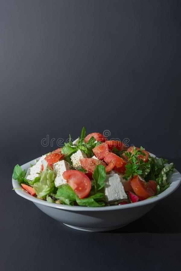 Large portion of raw salad and cheese. Large portion of raw salad, tomato and cheese stock image