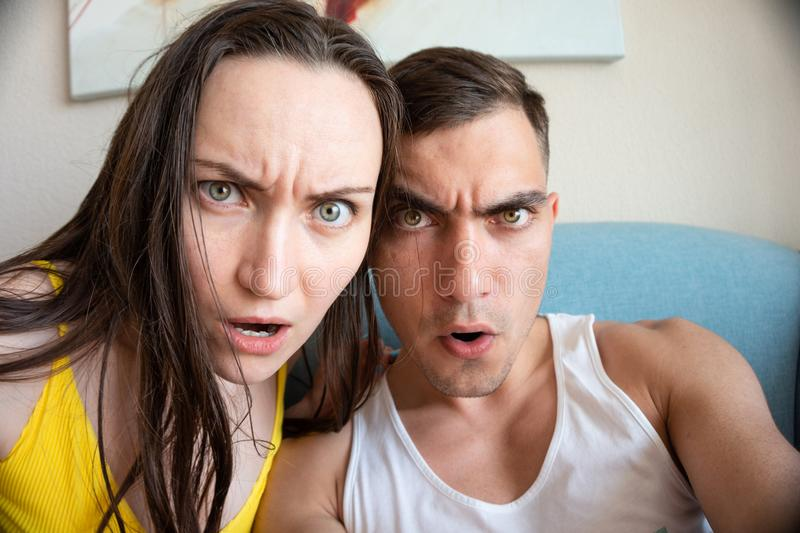 A large portrait of a selfie of a young couple, grimacing in front of the camera stock photo