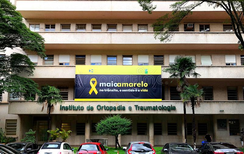 Yellow May Movement in Brazil. A large poster on the facade of a major public orthopedic hospital in Sao Paulo city. The poster is used to promote the Maio royalty free stock images