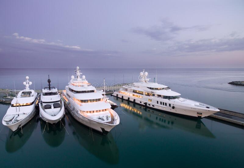 Large private super motor yacht in dock. Large white private super motor yachts in dock or port royalty free stock images
